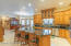 Remodeled Kitchen with Custom Built Solid Oak Cabinetry and Silestone Countertops