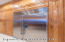 Stainless Steel Subzero Refrigerator encased by oversized custom pantry storage from the floor to the ceiling