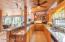 Summer Kitchen including Cypress Cabinets, Granite Countertops, Bar, Refrigerator, Dishwasher & Electric Dryer.