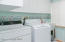 Laundry Room has ample storage space and a new tankless water heater.