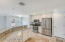 Bright, open kitchen with ample cabinetry and counter space...