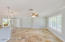 Beautiful travertine flooring throughout...crown molding accents the living space.