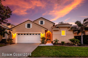 Front exterior, enjoy big skies in Suntree over Baytree Golf Course.