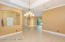 Formal dining towards foyer and formal living room.