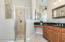 Master bath offers walk in shower with 2 shower heads.