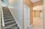 Hallway with stairs to bonus room.