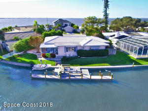 Beautiful mid-century inspired 3 BR, 2 BA, 2 Car Garage Waterfront Home in a protected harbor!