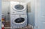 Stackable washer/dryer in laundry closet in each unit