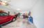 This deep and spacious 2-car garage has plenty of room for storage and work space.