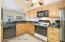 Eat -in Kitchen has granite countertops and pass thru bar top