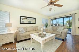 Comfortable living room to relax in with option to open up sliders.