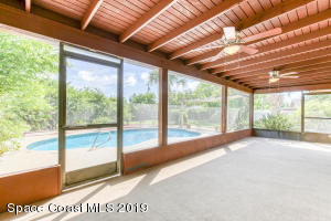 Large screened in area with beautiful wood ceilings