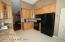 Large remodeled kitchen with new cabinets and granite counters