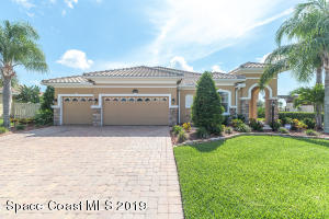Professionally Landscaped and Maintained Front Yard with Spacious Driveway