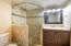 Complete re-model with all new plumbing, fixtures, tile .Large walk in shower with designer tile,