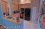Large remodeled kitchen with new cabinets and granite counters.