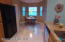 Large remodeled kitchen with new cabinets, granite counters and nook.