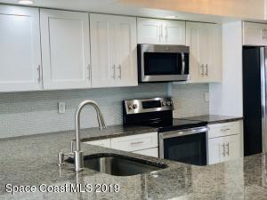 Granite Countertops All one Level with Maple Cabinets
