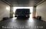 PREVOST RV in the door of the RV garage