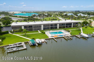 Rear Aerial view of the River Club Condominiums showing pool and water frontage