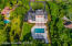 1.21 acres of privacy surrounded by natural oaks, evergreens & Florida palms