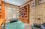 The Den has Custom Oak Bookcase, Desk & Built-Ins & Walk-In Closet.
