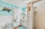 Bright and cheery ground floor ensuite bathroom with commode, walk-in shower, vanity and access to private sitting area with its own entrance.