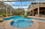 Hot tub with pool and lanai. Notice the balcony off of the bonus room above the lanai.