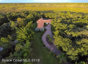 This 5188 SF property is privately nested on nearly 4 acres backing up to a 5000 acre bird sanctuary.