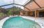 Screened pool enclosure with large patio/entertainment area