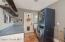 Spacious laundry room with work counter and cabinet storage