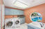 Lots of Cabinets,Sink, built in ironing board and Washer and Dryer are included.