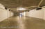 Transfer aisle to oversized private garages on first floor