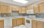 Updated appliances, counters, and backsplash make this kitchen ready for you!
