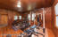 Currently used as a workout room, but this can be used as the master, an in-law suite, office, etc. Room has it's own bathroom and closets and is connected to the main house by a screen porch/breezeway.
