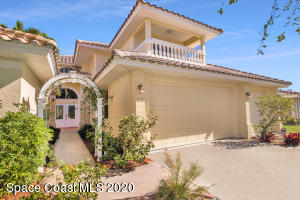Updated Cocoa Beach home with 3 car garage and separate Guest house perfectly located!