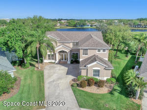 5 bedroom 3 bath, Loft and over sized bonus room with 3 car garage, pool and hot tub on the golf course over looking the lake and greens.