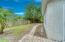 LARGE PRIVACY FENCED YARD WITH PAVER PATHWAYS
