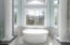 Free Standing tub with decorative columns. Vaulted Ceiling