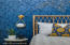 Gorgeous lighting and wallpaper in master bedroom