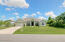 Large fron yard with mature landscaping offer privacy.