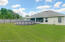 Large fenced backyard perfect for family games and activities.