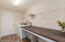 Spacious laundry room with large counter perfect for folding and sorting lanudry.