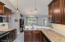 Open concept kitchen with breakfast bar overlooks the dinign area and great room.