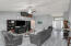 Bright and airy great room with vaulted ceilings and maintenance free flooring.