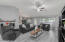 Spacious open concept great room with ceiling fan,