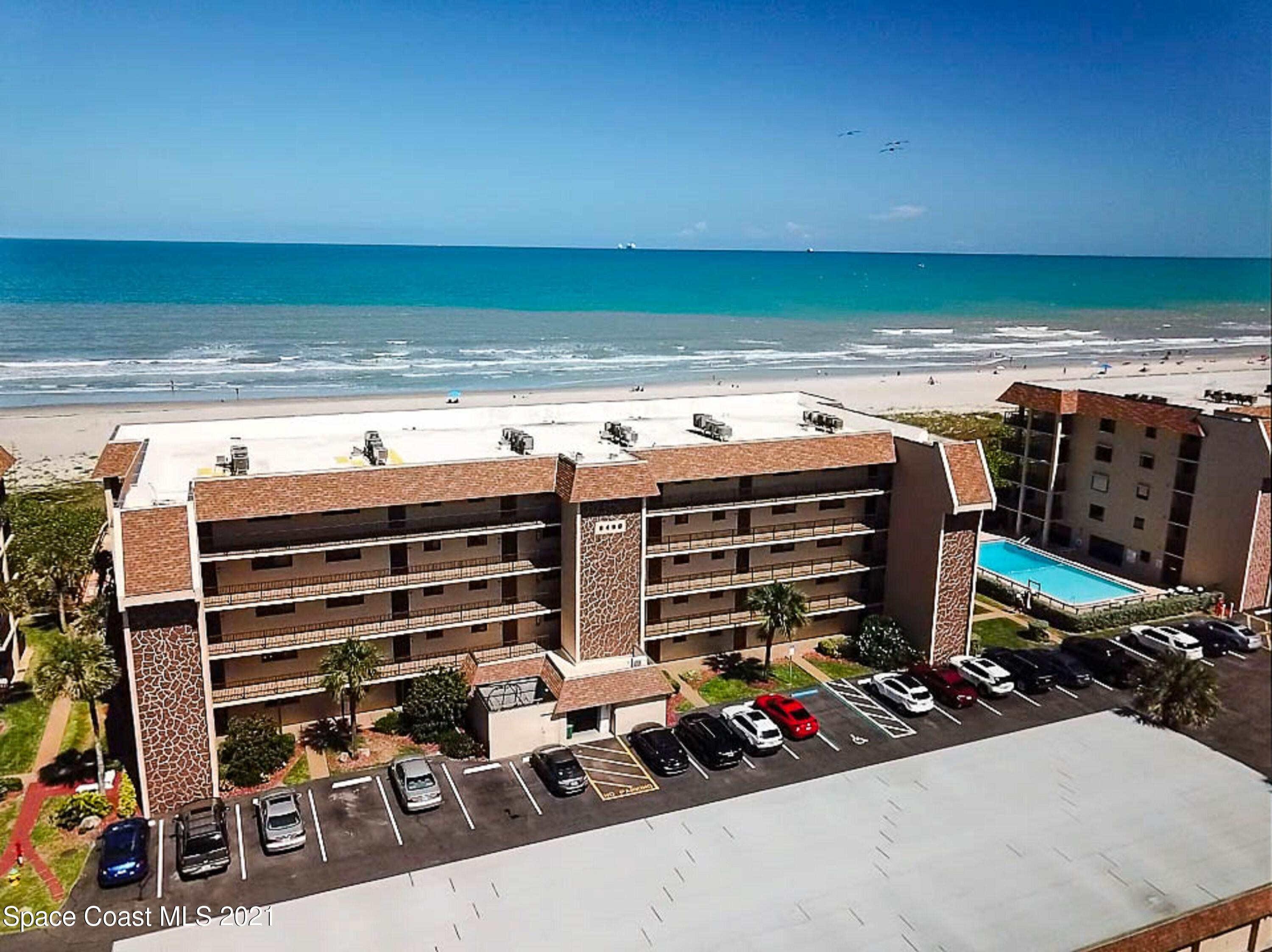 Direct Oceanfront 2 Bed 2 Bath fully furnished condominium in the highly sought after Canaveral Sands Community. As you enter the unit, you enter the well appointed kitchen with loads of cabinets and ample counter top space. The kitchen also features a breakfast bar that connects to the dinette. The dining area is spacious and can accommodate a large table suitable for hosting a large family. The dining area then flows into the living room which is a fantastic size and provides immediate access to the outdoor patio. The master suite is large with ample room for a sitting area as well as a walk in closet and newly renovated walk in shower. The second bedroom is spacious and currently holds two full beds with ample closet space. The rear covered patio is amazing with enclosed storage for all your beach toys. The community pool and beach access are literally steps away from the back of the covered patio. The Canaveral Sands community is well maintained and provides access to great amenities to include a nice sized pool and wash down. In addition, this community is minutes away from Port Canaveral and endless dining and entertainment options. If you're looking for direct oceanfront beach condo that's in the center of it all, then look no further, you're home.