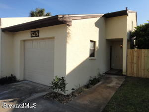 Just 1 block to the most beautiful beach, located between the Jetty's and the Pier. Updated townhome with no HOA.  Currently  used as an Air B n B making this a great investment. Offering 2 master suites with a balcony off one of the master bedrooms. Kitchen re modeled  in 2015, hurricane windows 2015 and freshly painted in 2020.  This 2 bedroom 2 1/2 bath townhome is steps to the beach and a short 45 minute drive to Orlando.  Great investment, weekend getaway or perfect for making it your beach retreat!