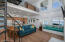 living room/spiral staircase & kitchen