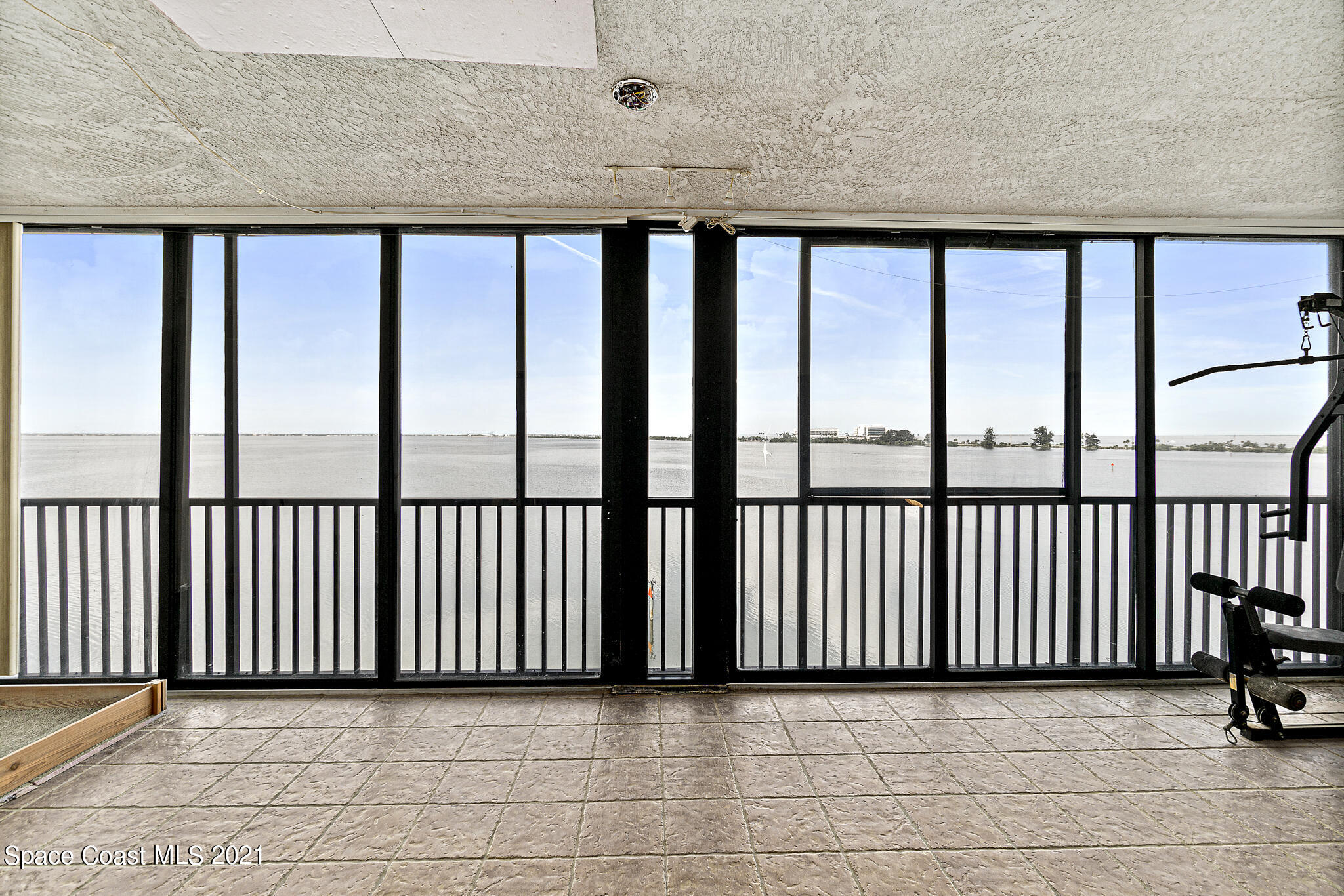 Phenomenal sunset views over the Banana River from this TOP FLOOR, CORNER UNIT that's located in the desirable Rock Pointe complex. This spacious unit boasts an enviable floor plan with 2 bedrooms & 2 separate balconies. A wide foyer welcomes you and leads to the living & dining area with sweeping views of the river. The potential is endless, this unit is ready for you to come make it home. Kitchen offers breakfast bar seating and solid surface countertops. The large primary suite features even more water views, a slider to the balcony and walk-in closet. This complex has it all, secure lobbies, heated pool & spa, clubhouse with exercise room, tennis court, fishing dock & kayak entry off boardwalk and vehicle wash area, plus unit comes with a private, under building 1 car garage.